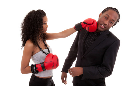 Young black woman fighting with her boyfriend, over white background - Black people photo