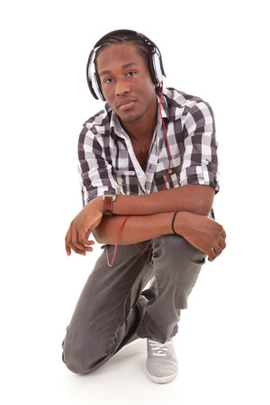 Young african american man with headphones, isolated on white background - Black people photo