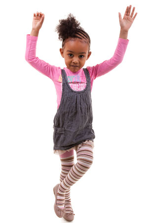 afro caribbean: Portrait of an african american little girl, over white background - Black people Stock Photo