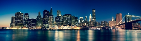 New York - Panoramic view of Manhattan Skyline by night Stock Photo