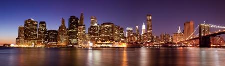 hudson river: New York - Panoramic view of Manhattan Skyline by night Stock Photo