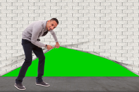 Young african american man lifting the wall to look behind - Black people