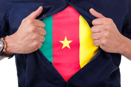 cameroonian: Young sport fan opening his shirt and showing the flag his country cameroon - Cameroonian flag