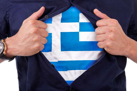 Young sport fan opening his shirt and showing the flag his country Greece, Greek flag photo