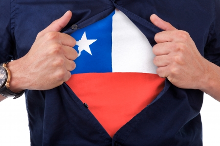 Young sport fan opening his shirt and showing the flag his country Chili, Chilean flag photo