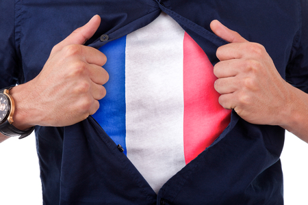Young sport fan opening his shirt and showing the flag his country France, French flag photo