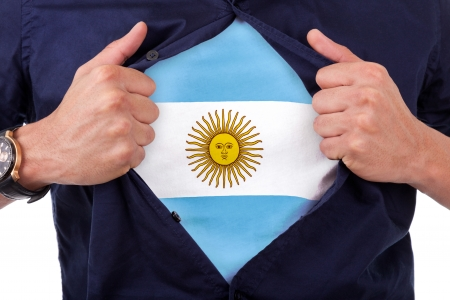 Young sport fan opening his shirt and showing the flag his country argentina, argentinian flag Stock Photo