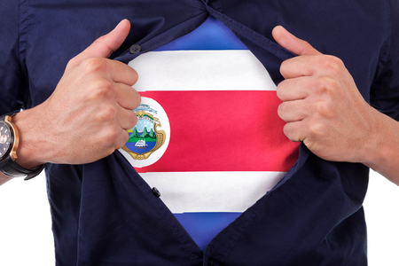 costa rican: Young sport fan opening his shirt and showing the flag his country costa rica, costa rican flag Stock Photo