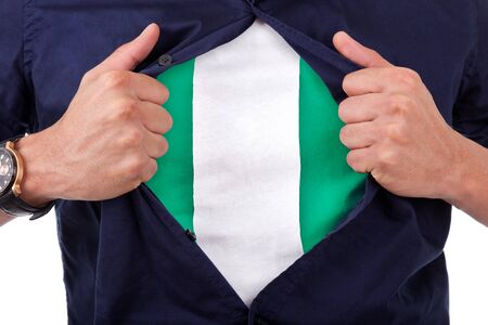 country nigeria: Young sport fan opening his shirt and showing the flag his country nigeria, nigerian flag Stock Photo
