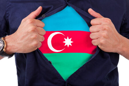 azerbaijani: Young sport fan opening his shirt and showing the flag his country Azerbaijan, Azerbaijani flag Stock Photo