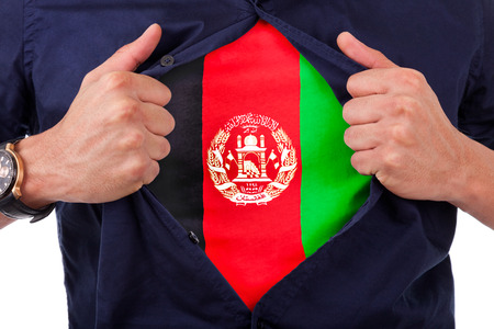afghan flag: Young sport fan opening his shirt and showing the flag his country afghanistan, afghan flag Stock Photo