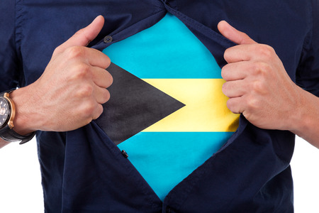 bahamian: Young sport fan opening his shirt and showing the flag his country Bahamas, Bahamian flag