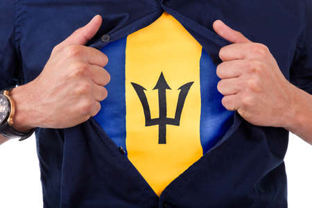 barbadian: Young sport fan opening his shirt and showing the flag his country Barbados, Barbadian flag Stock Photo