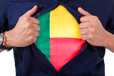 Young sport fan opening his shirt and showing the flag his country Benin, Beninian flag photo