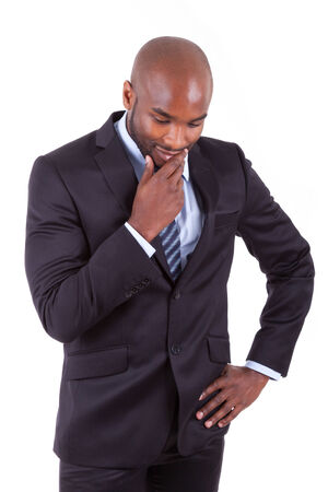 Portrait of a young African American business man thinking, isolated on white background photo