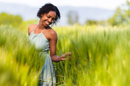 African American woman in a wheat field - African people photo