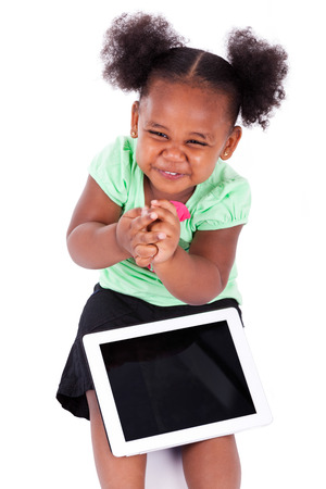 Little african american girl using a tablet  pc, isolated on white background photo