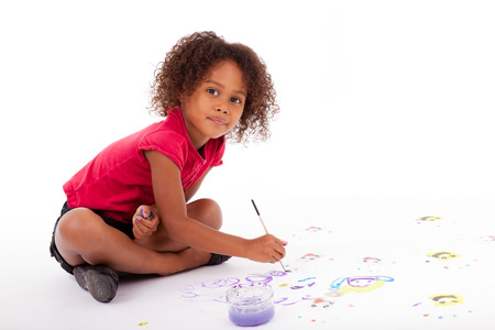 afro caribbean: Cute Little African American girl painting on the floor