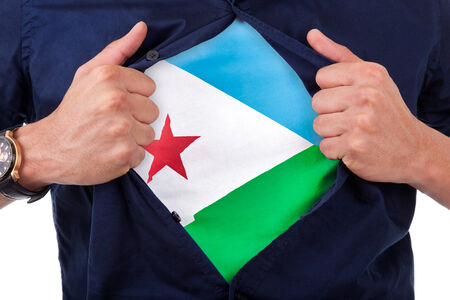 Young sport fan opening his shirt and showing the flag his country Djibouti, Djiboutian flag photo