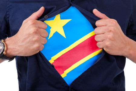 Young sport fan opening his shirt and showing the flag his country Republic Democratic of Congo photo