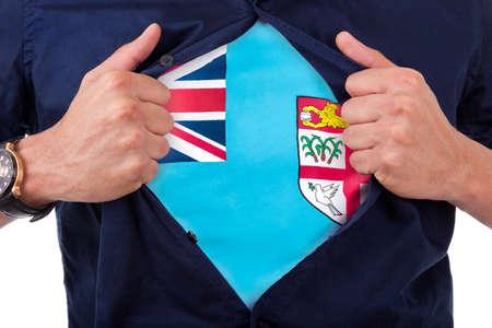 fijian: Young sport fan opening his shirt and showing the flag his country fiji island, Fijian flag