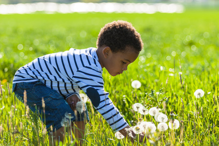 Cute african american little boy playing outdoor - Black people photo