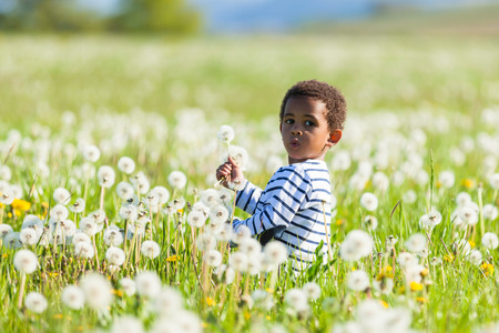 sitted: Cute african american little boy playing outdoor - Black people