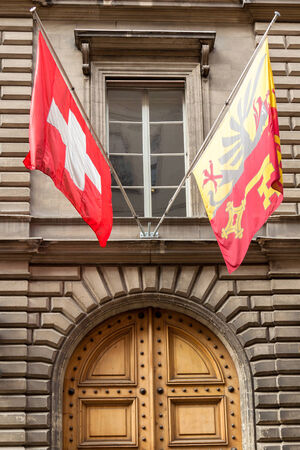 neutrality: Swiss and Geneva flag floating in the air