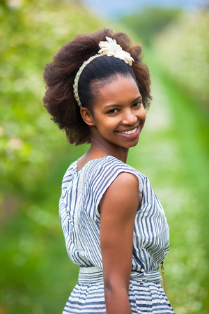Outdoor portrait of a young beautiful african american woman - Black people photo