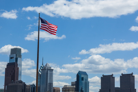 American flag stars and stripes  floating in front of the  - Philadelphia skyline - Pennsylvania - USA photo