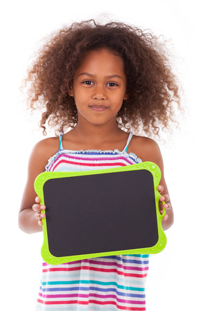 African American school girl holding a blank  black board, isolated on white background - Black people