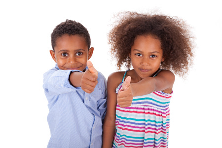 African American boy and girl making thumbs up gesture, isolated on white background - Black people photo