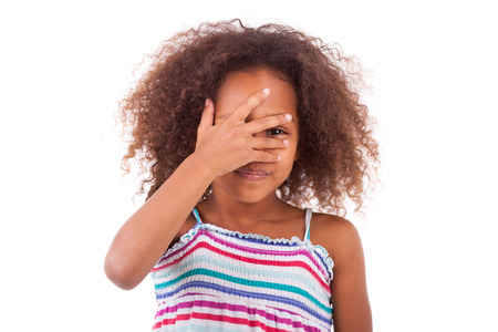 blind child: Cute young African American girl hiding her eyes, isolated on white background - Black People