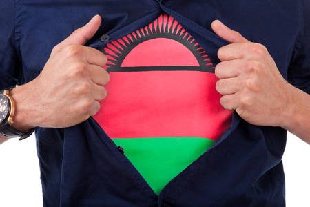 malawian flag: Young sport fan opening his shirt and showing the flag his country Malawi,  Malawian flag Stock Photo