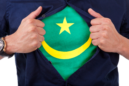 national hero: Young sport fan opening his shirt and showing the flag his country Mauritania,  Mauritanian flag Stock Photo