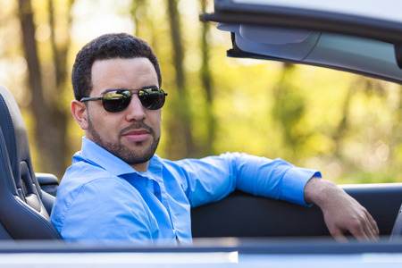 Young black latin american driver  driving his new car photo