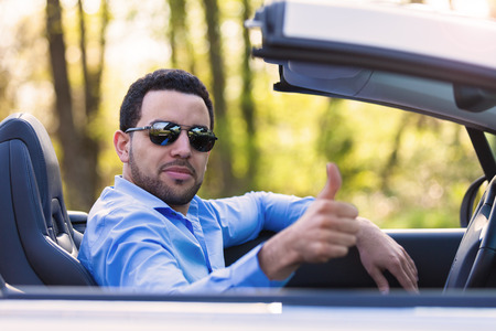 Young black latin american driver making thumbs up - Black people photo