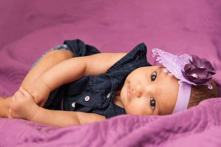 african american infant: Adorable little african american baby girl looking - Black people