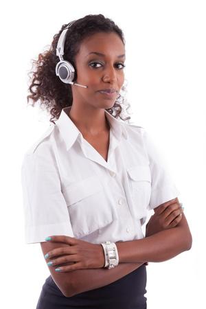 African American helpdesk worker holding headset - Black people photo
