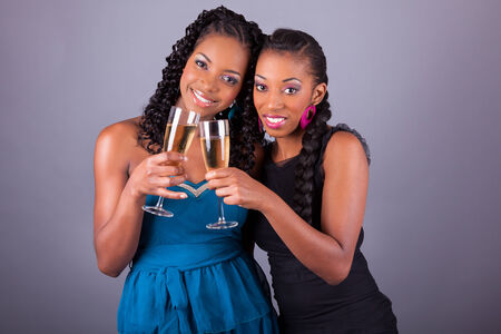 woman dress: Young beautiful African American womans holding a glass of champagne Stock Photo