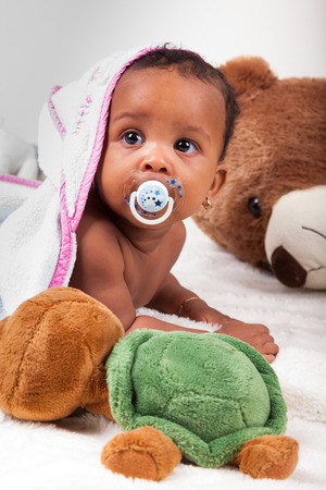 Adorable little african american baby girl  looking up Stock Photo
