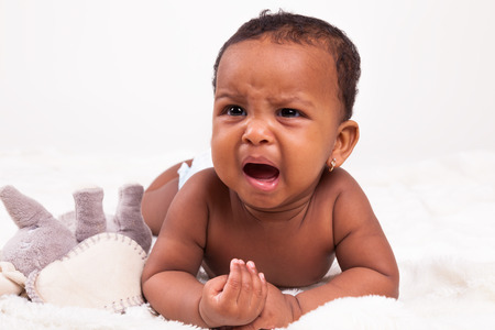 mixed race girl: Adorable little african american baby girl crying - Black people Stock Photo