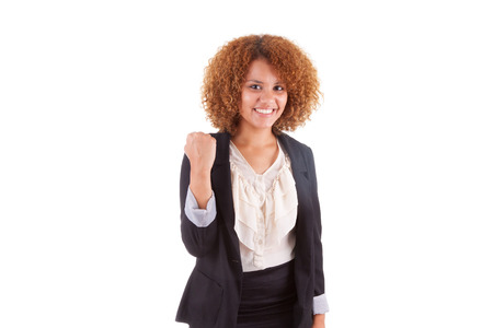 south american: Portrait of a young african american business woman with clenched fist , isolated on white background - Black people