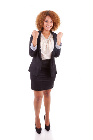 Portrait of a young african american business woman with clenched fist , isolated on white background - Black people photo