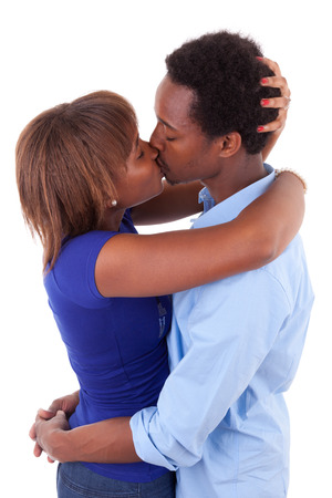 African American young couple kissing - Black people, isolated on white background photo