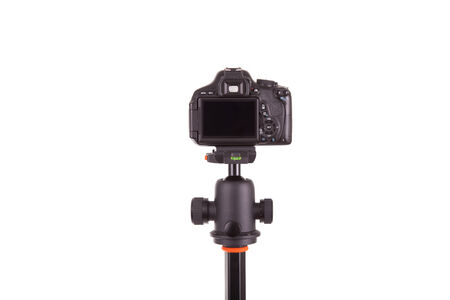 tripod mounted: Digital camera mounted on tripod, isolated on white background Stock Photo