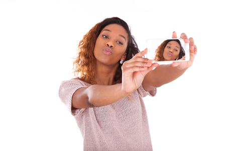 brazilian caribbean: Young African American woman taking a selfie - self portrait - Black teenager people