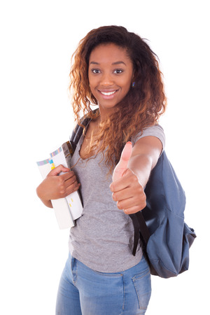 African American student girl holding books making thumbs up sign - Black people Stock Photo