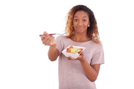 black teens: African American woman eating salad, isolated on white background