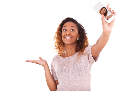african american: Young African American woman taking a selfie Stock Photo